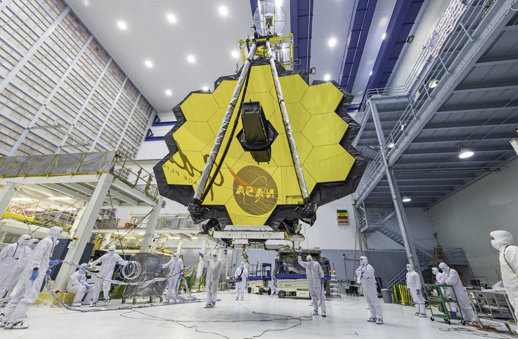 NASA technicians lift the James Webb Space Telescope with a crane and move it inside a clean room at NASA's Goddard Space Flight Center in Greenbelt, Maryland.