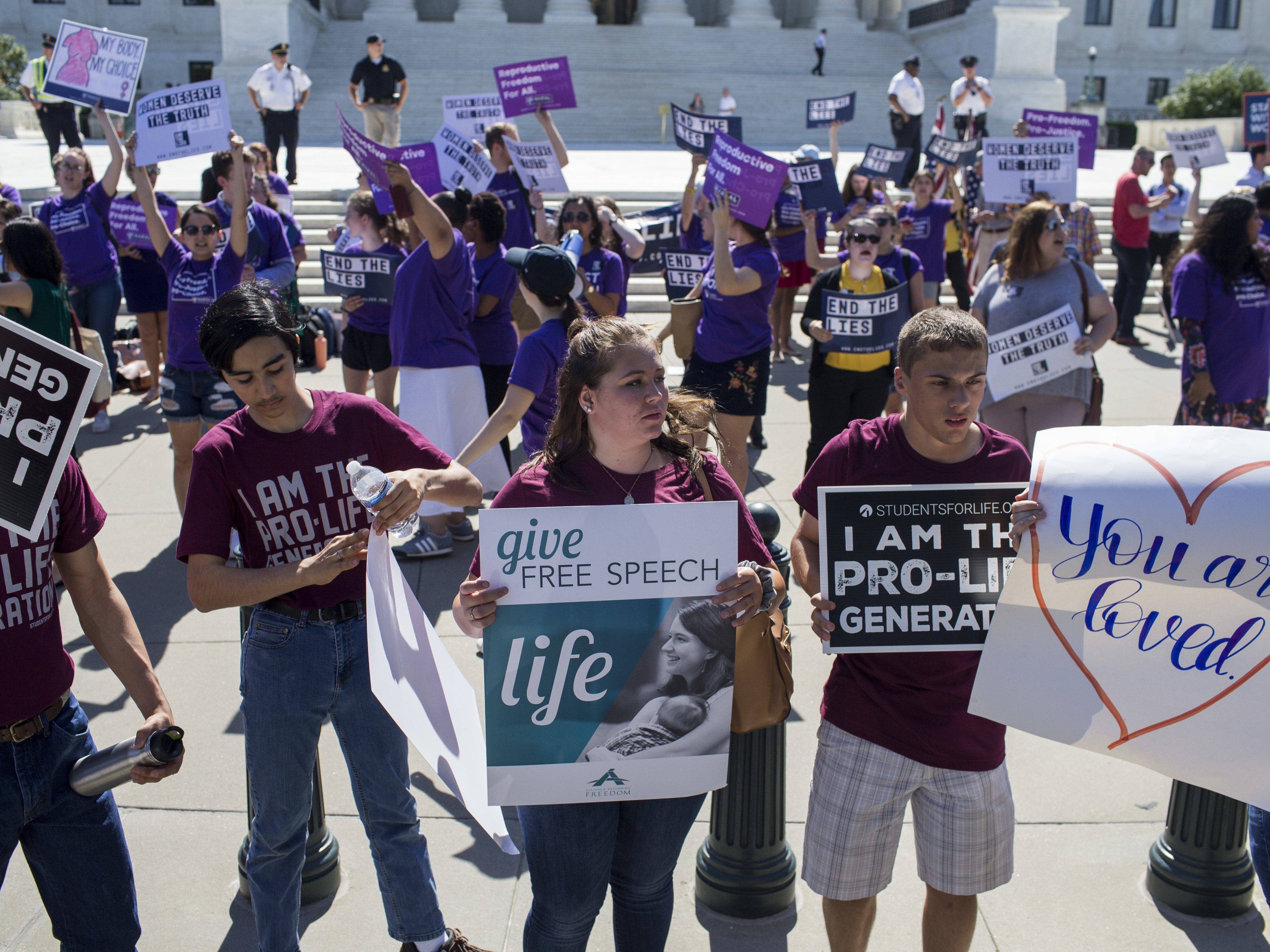 Abortion and anti-abortion rights groups rally at the Supreme Court on Monday. Almost as soon as Justice Anthony Kennedy's retirement was announced, several anti-abortion rights groups began their campaigns to influence the pick for his successor.