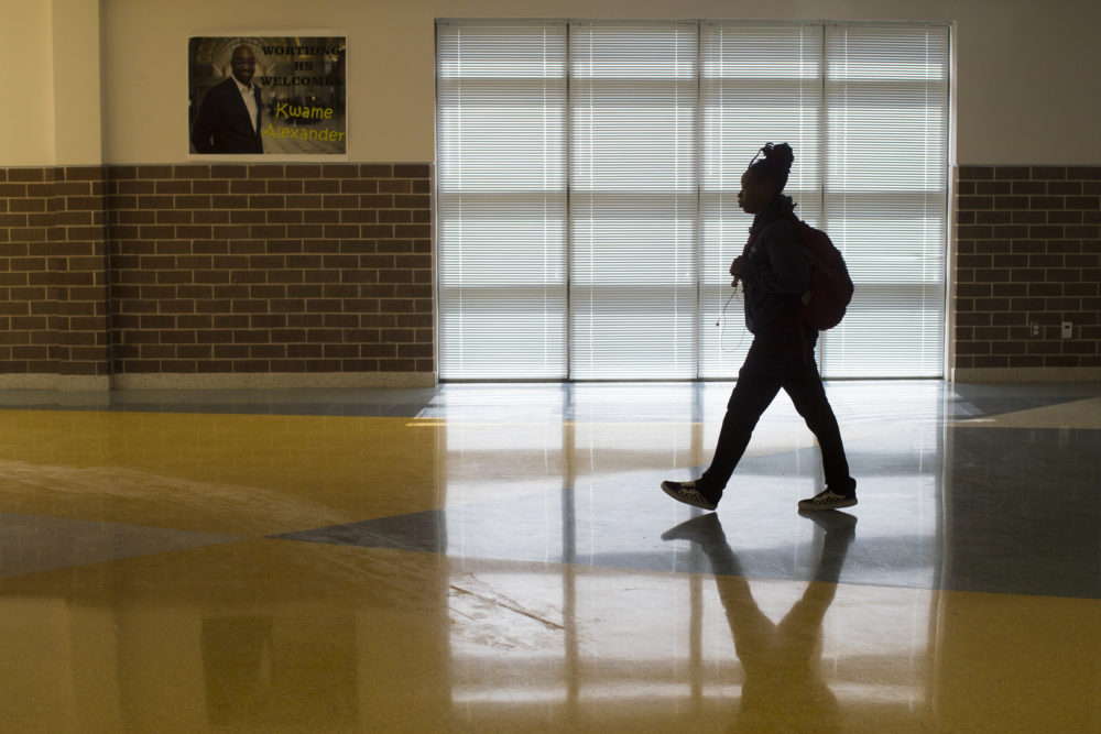 A Worthing High School student walks between classrooms on Thursday, April 5, 2018, in Houston. ( Marie D. De Jesus / Houston Chronicle )