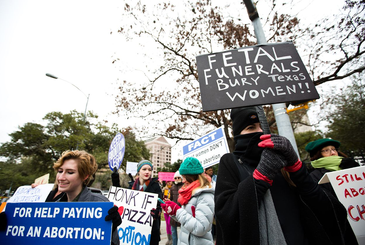 Protestors of Texas' fetal remains burial rule gather outside the Governor's Mansion on Jan. 6, 2017.