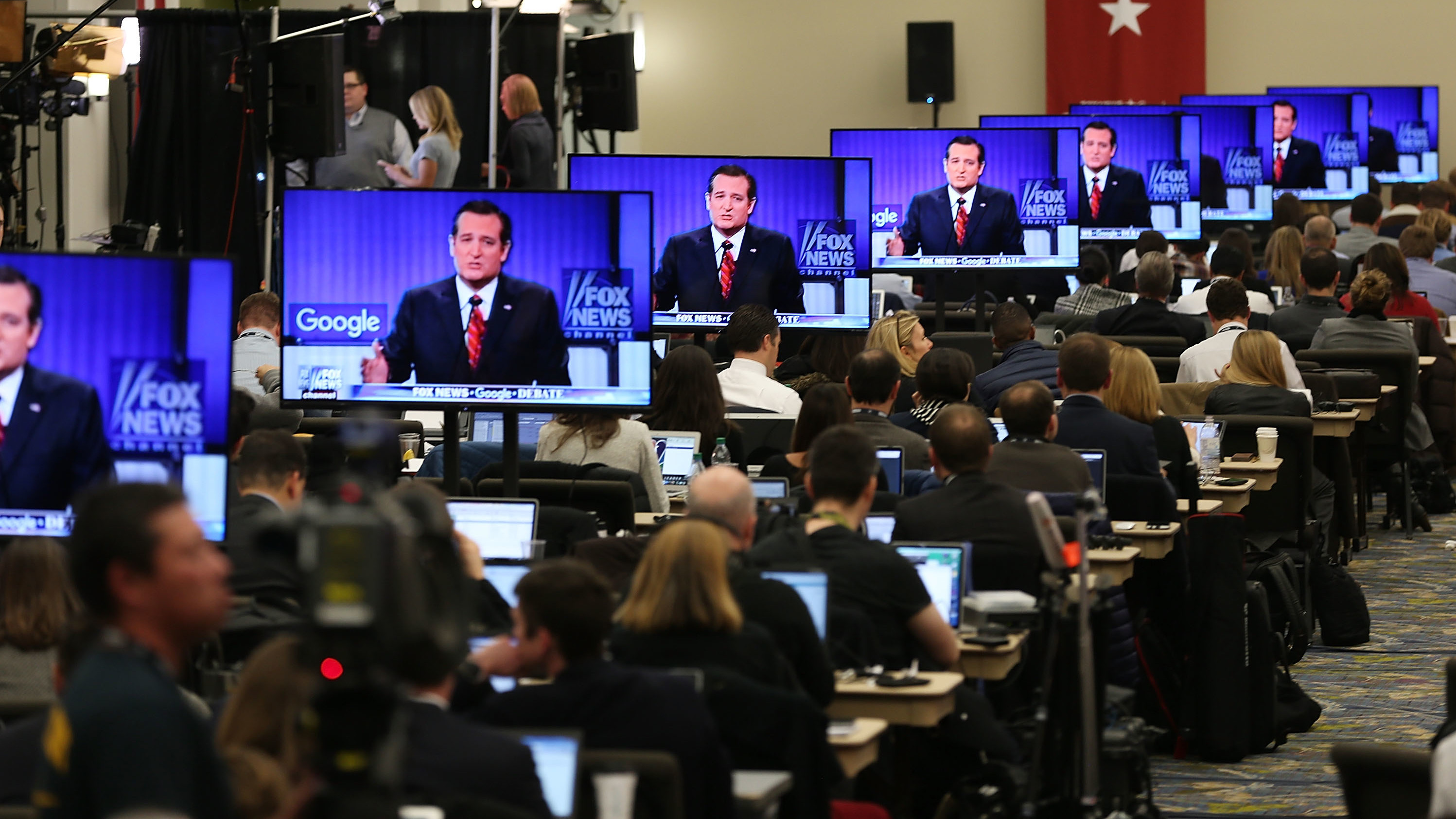Television screens are tuned to a Republican presidential debate sponsored by Fox News and Google in January 2016.
