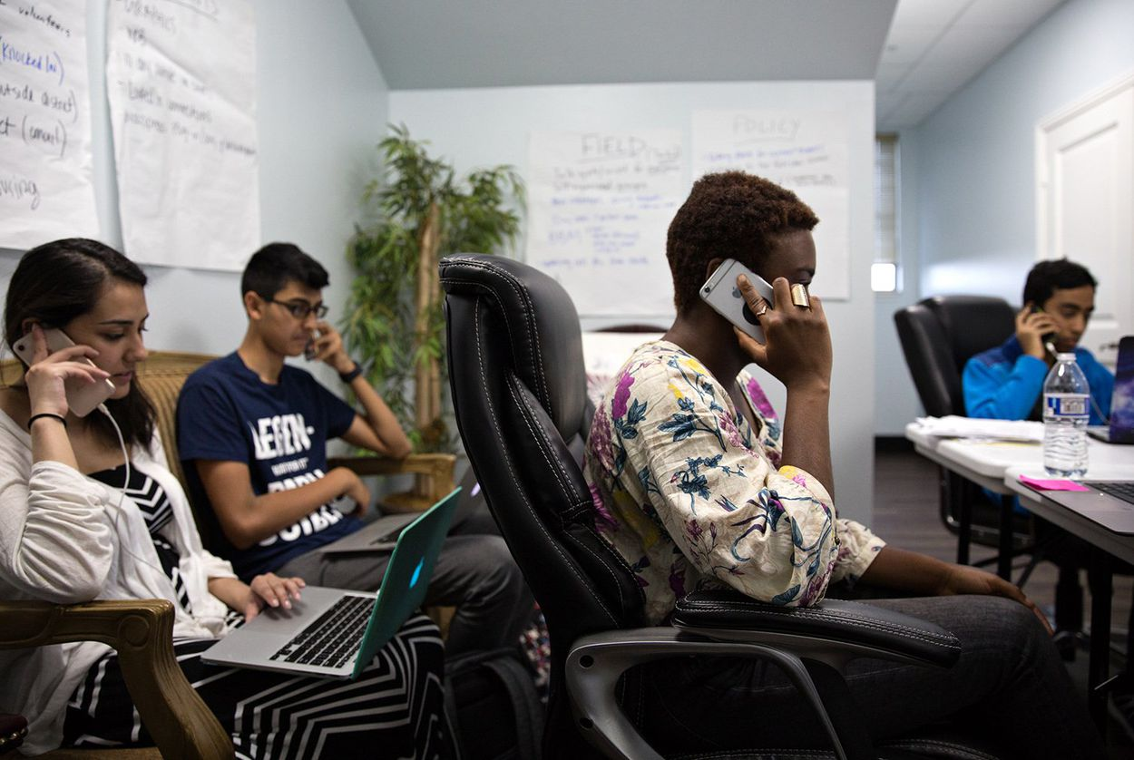 Campaign volunteers for Sri Kulkarni, a Democrat vying to unseat U.S. Rep. Pete Olson, R-Sugar Land, work the phones before a primary runoff in May.