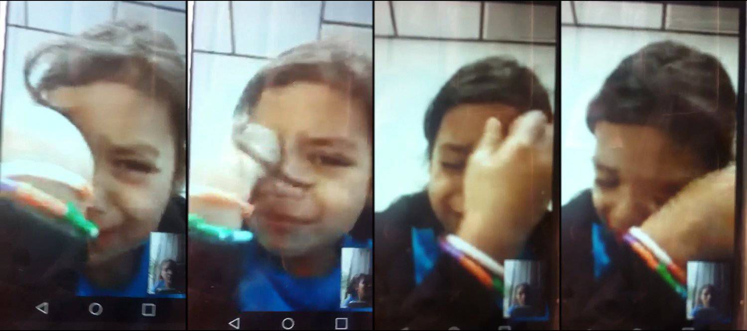 Six-year-old Heyli in a video call with her mother, Claudia, on July 20.