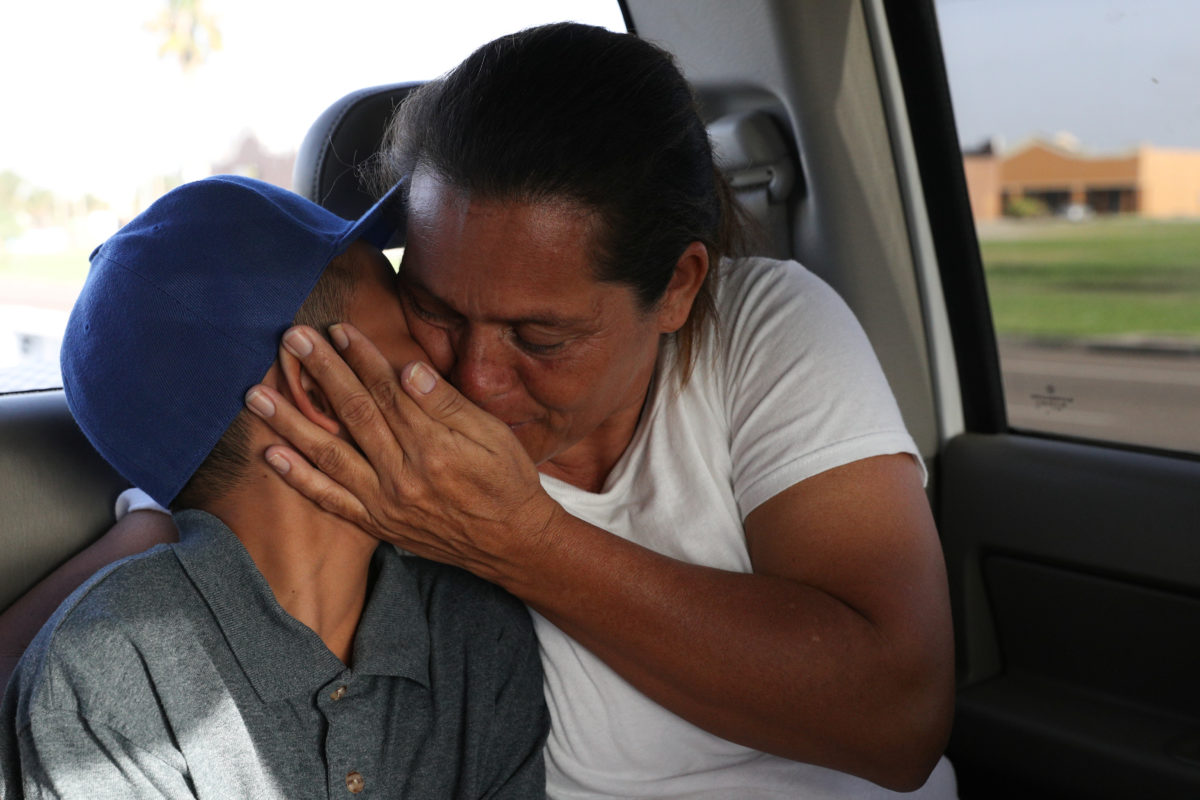 Left: Maria Marroquin Perdomo and her 11-year-old son Abisai drive away from the Casa Padre facility in the backseat of her attorney's truck minutes after mother and son were reunified in Brownsville, Texas, on July 14, 2018. Abisai was held at Casa Padre while his mother was detained at the Port Isabel detention facility.
