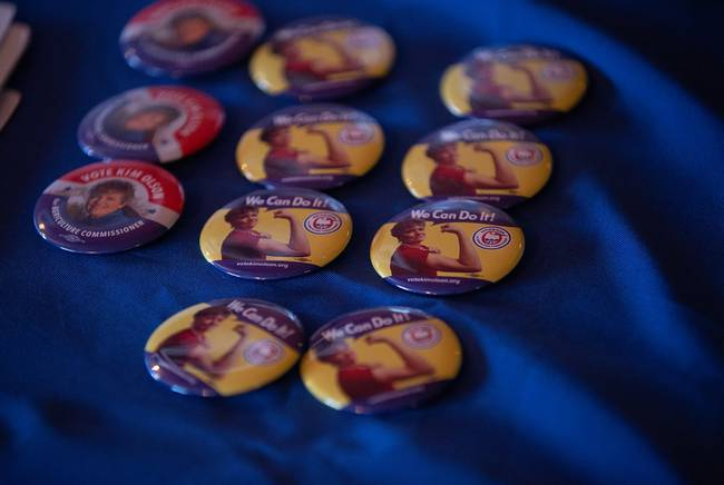 Olson's campaign displays Rosie the Riveter pins at a fundraiser in Midland in July.