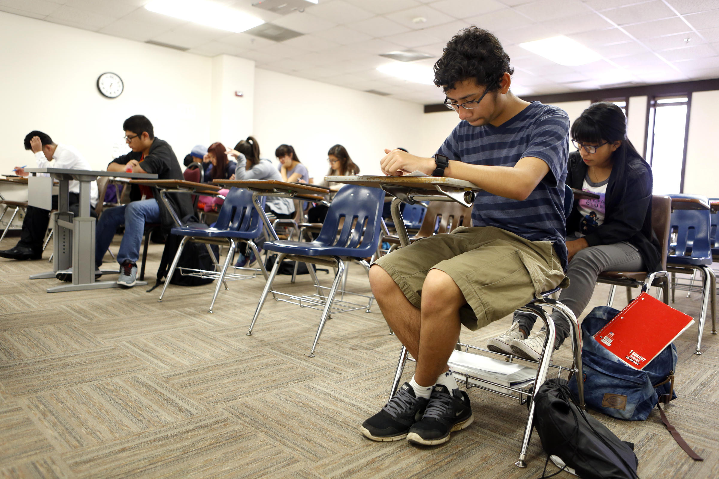 Joel Luera takes a quiz during a history class at Eastfield College Campus where he takes classes as part of W.W. Samuell Early College High School in Dallas. Photographed Monday, April 18, 2016. (photo © Lara Solt)
