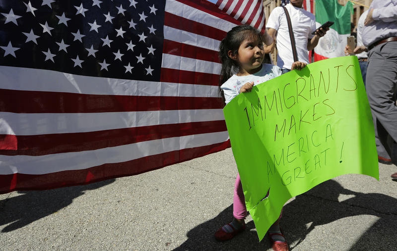 Yaretzi Perez, 4, holds a sign as she joins her family and others during an immigration protest, Thursday, Feb. 16, 2017, in Austin, Texas. Immigrants around the U.S. stayed home from work and school in a nationwide