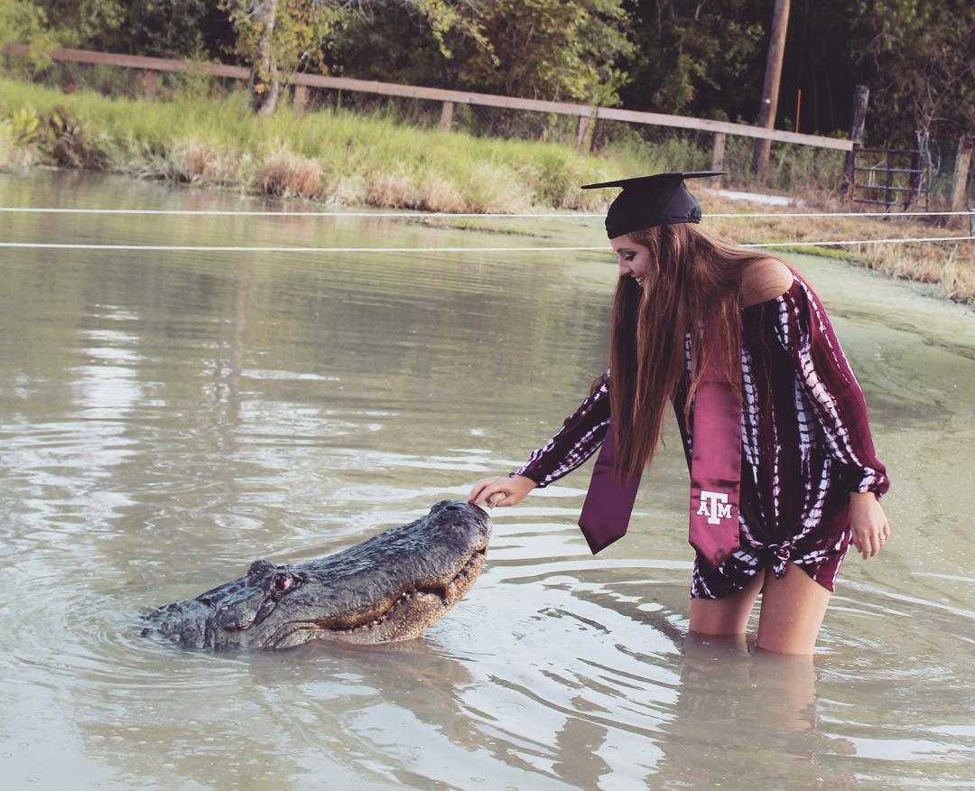 Makenzie Noland of Abilene posted photos of the huge gator on her Facebook page as she plans to graduate Friday in College Station.