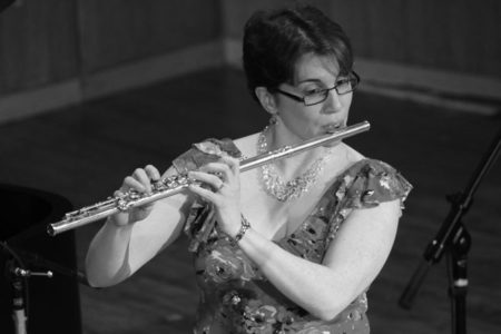 Black and white photo of flute player Meg Griffith