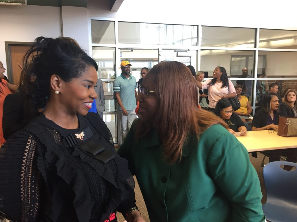 Interim Superintendent Grenita Lathan and Worthing's principal, Khalilah Campbell-Rhone, celebrate the school's improvement.