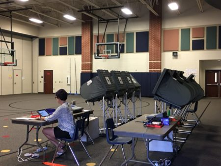 A Harris County election clerk works at the polling location at McNabb Elementary School, in Spring, on election day.
