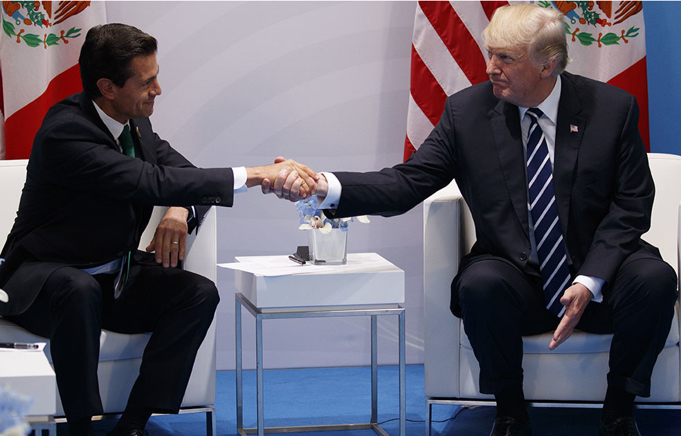 Mexican President shakes hands with Donald Trump