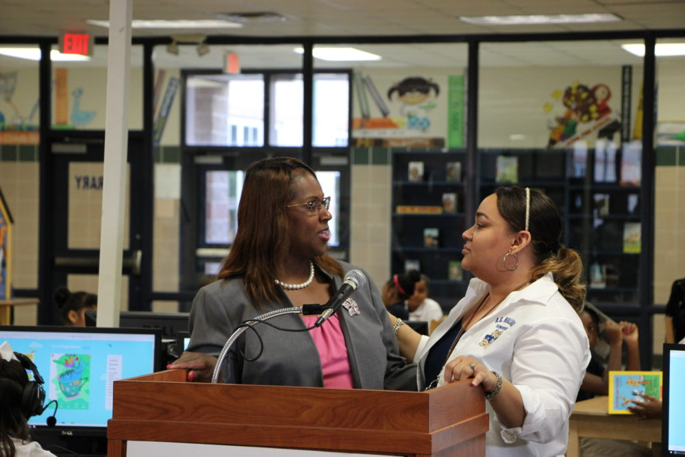 Interim Superintendent Grenita Lathan congratulates Hilliard Elementary's assistant principal, Bathsheba Nash, for the resilience her students have shown.