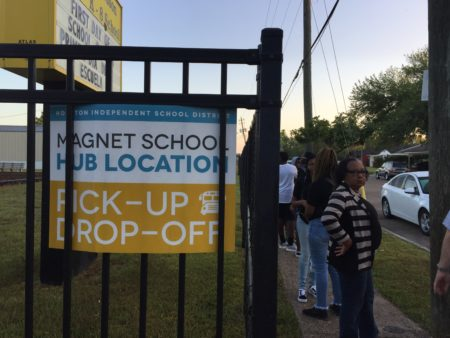 Families wait in line on the first day of school at the magnet bus hub stop at Wilson PK-5 on Monday, Aug. 27, 2018. Problems have plagued the new bus system all week.