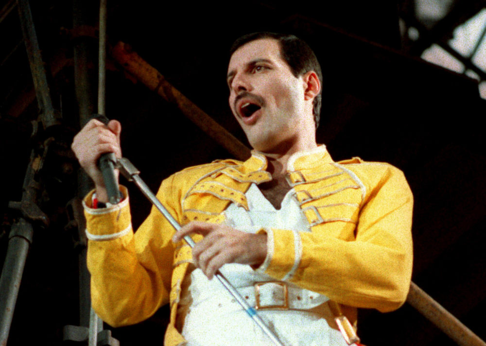 "FILE - In this July 20, 1986 file photo, Queen lead singer Freddie Mercury performs, in Germany. Queen guitarist Brian May says an asteroid in Jupiter's orbit has been named after the band's late frontman Freddie Mercury on what would have been his 70th birthday, it was reported on Monday, Sept. 5, 2016. May says the International Astronomical Union's Minor Planet Centre has designated an asteroid discovered in 1991, the year of Mercury's death, as ""Asteroid 17473 Freddiemercury."""
