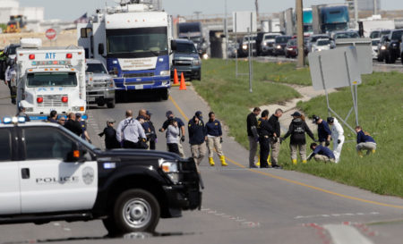 Officials continue to investigate the scene where a suspect in a series of bombing attacks in Austin blew himself up as authorities closed in, Wednesday, March 21, 2018, in Round Rock, Texas. (AP Photo/Eric Gay)