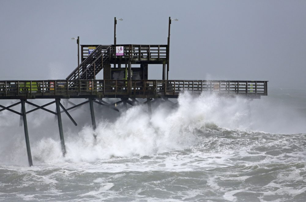 Waves from Hurricane Florence pound the Bogue Inlet Pier in Emerald Isle N.C., Thursday, Sept. 13.