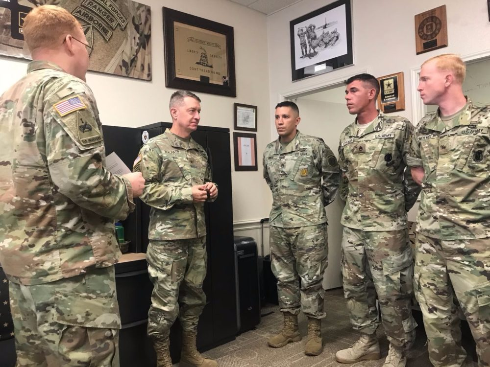 Brigadier General Jason Walrath (second from the left) speaks to recruiters at a recruiting station in Katy, TX.