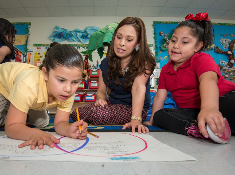 Alma Guerra works with her kindergarten students at Bruce Elementary School.