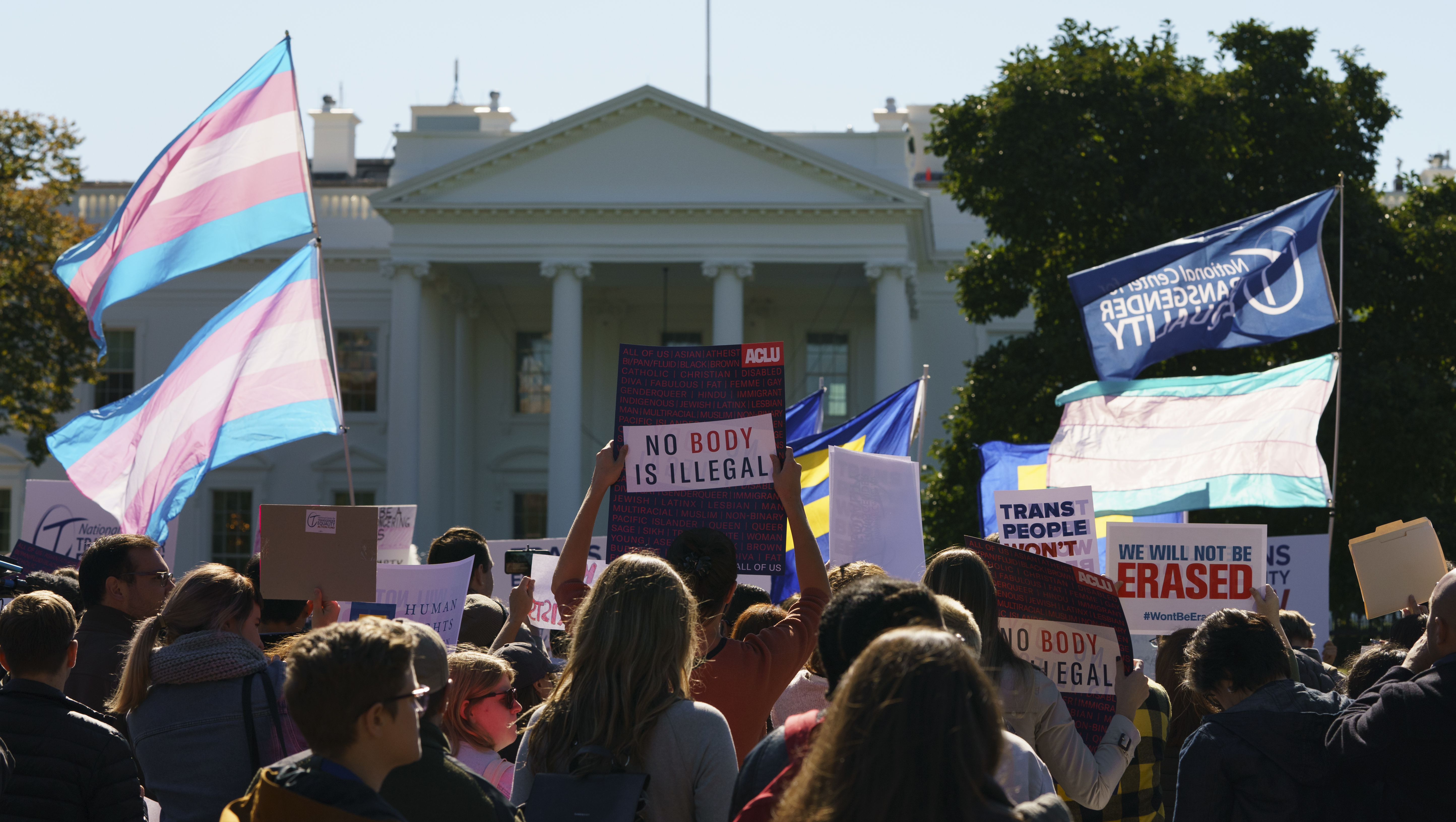Protestors with the National Center for Transgender Equality (NCTE) and the Human Rights Campaign gather in front of the White House on Oct. 22, 2018, for a #WontBeErased rally.
