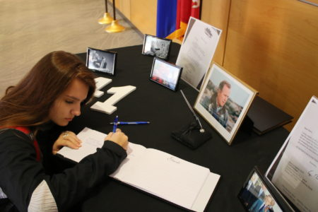 Senior Sydney Greene signs a book of condolences that will ultimately head to the Bush Presidential Library in College Station.