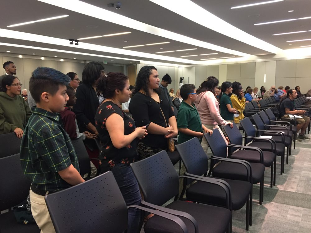Several dozen parents and students celebrated when the HISD board decided to renew the contracts with their charter schools.