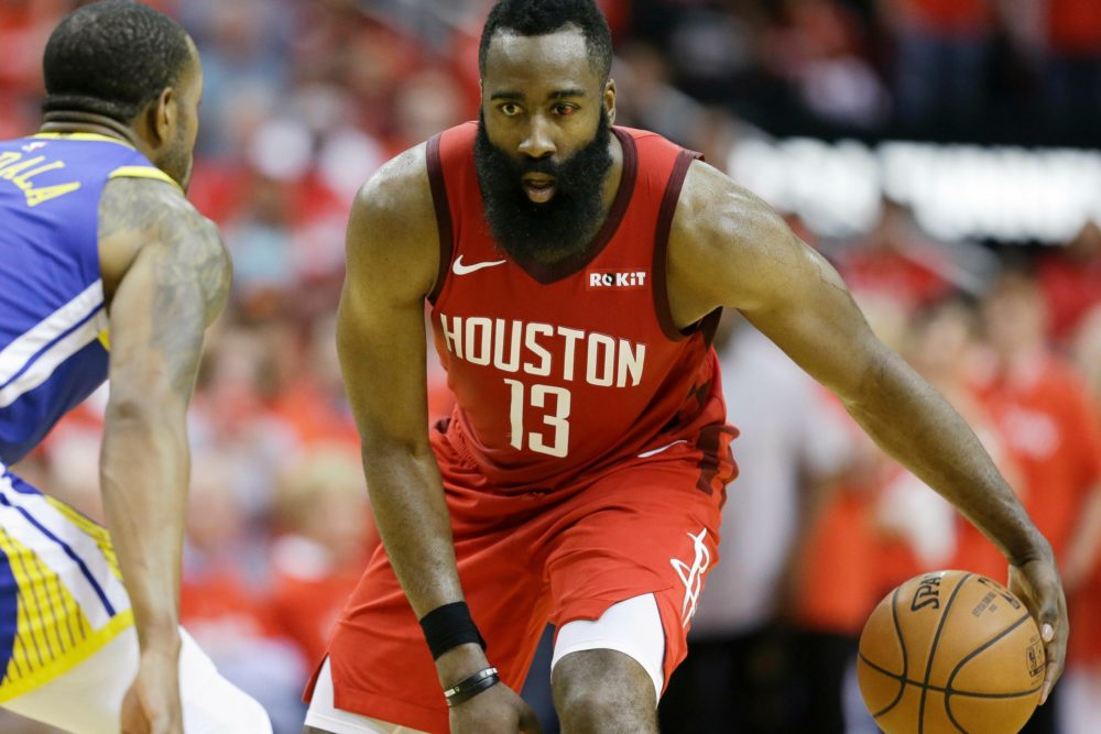 James Harden dribbles with an injured eye