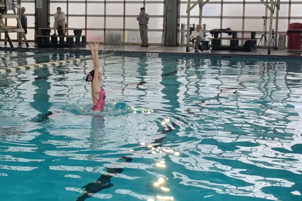 Synchronized Swimmer Performs