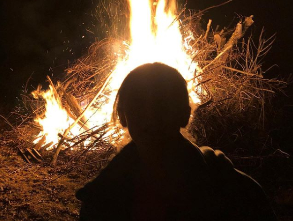 Child in Front of a Fire