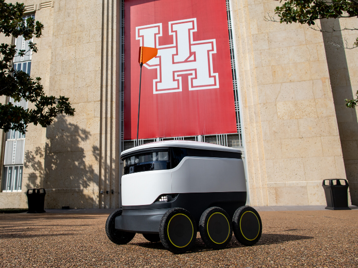 Delivery Robot in Front of UH Sign