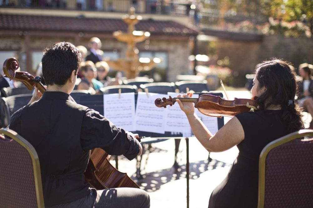 classical musicians playing outdoors