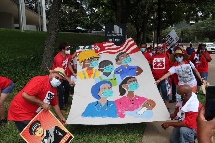 Airline workers rally for Congress to extend protections and prevent layoffs during the pandemic.