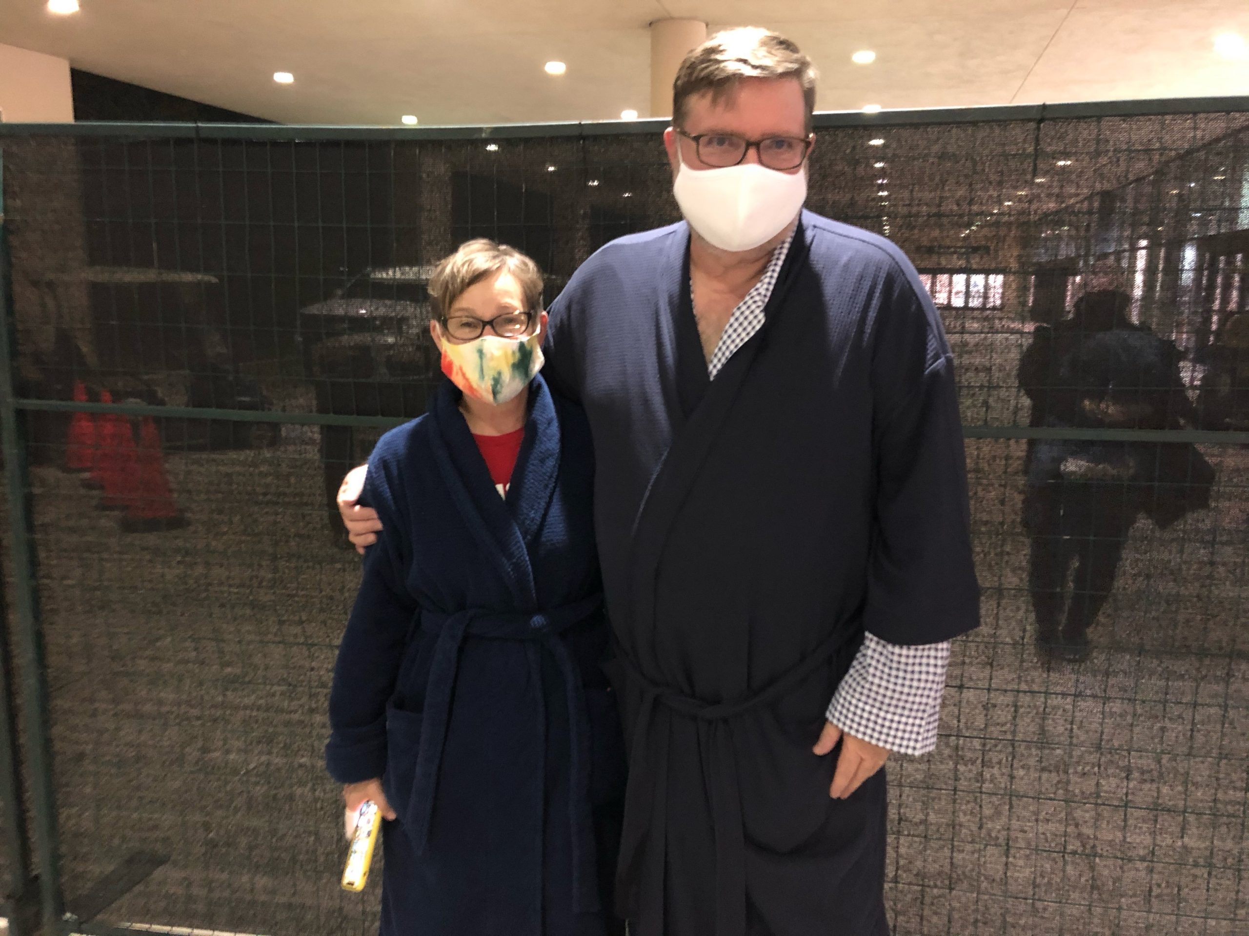 A couple in bathrobes at NRG Park took advantage of Harris County's historic opportunity to vote all night.